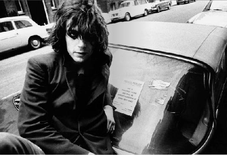 Mick Rock - Syd Barrett - Syd on his old car, 1969